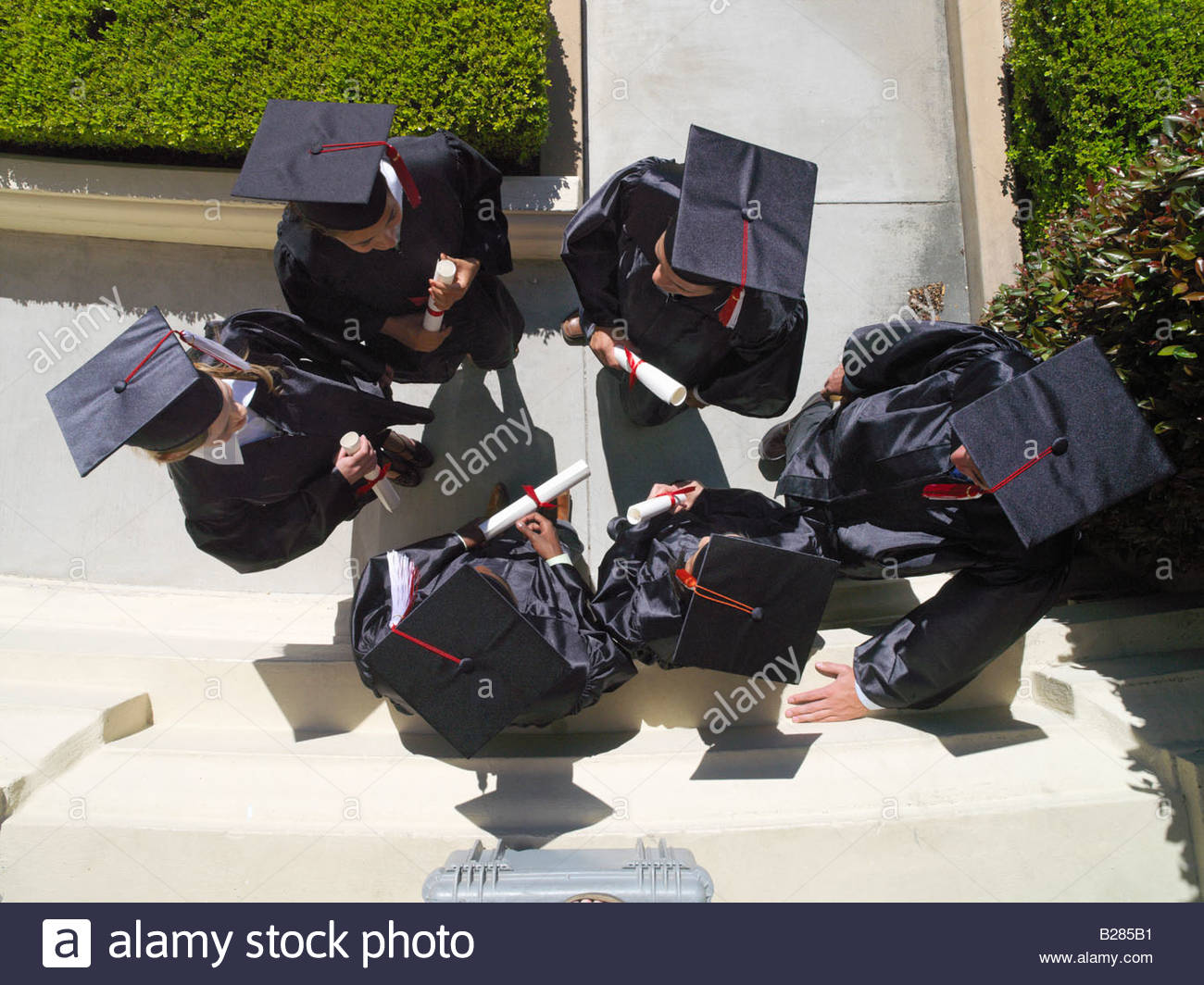 Graduates in caps and gowns, elevated view - Stock Image