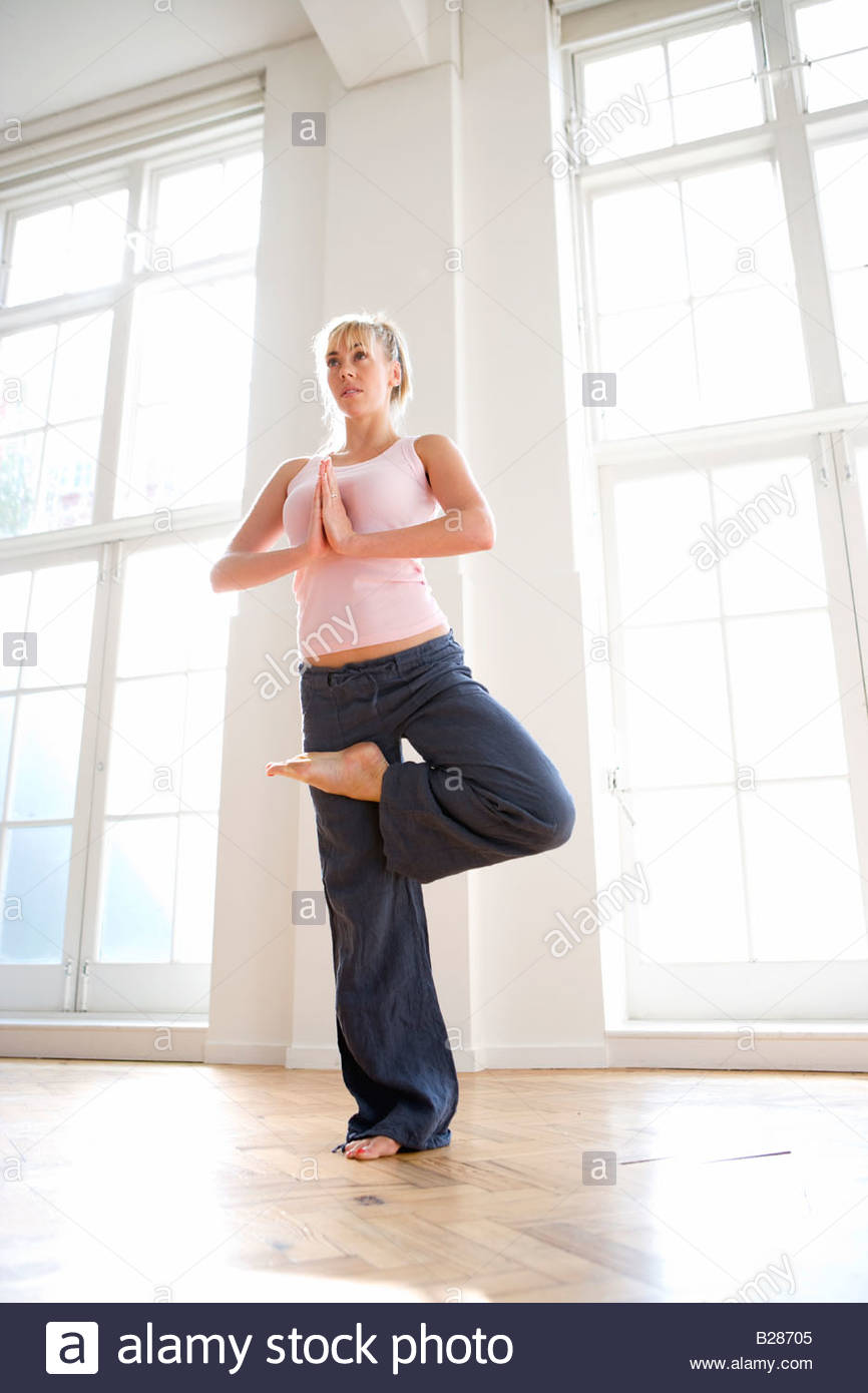 Woman in tree pose, low angle view - Stock Image