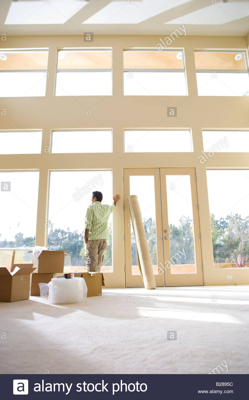 Man admiring view from new home - Stock Image