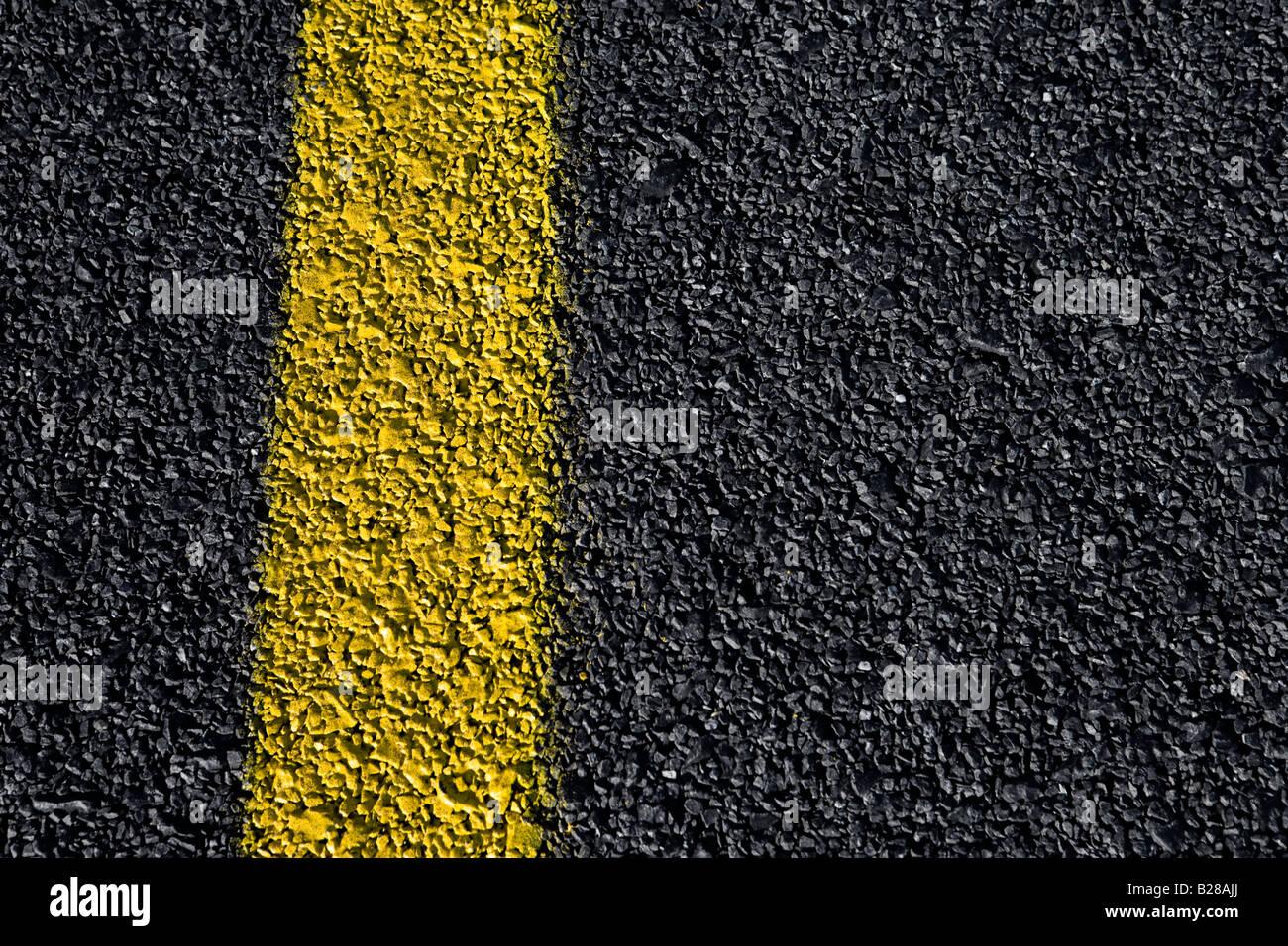 Yellow Line on Asfalt - Stock Image