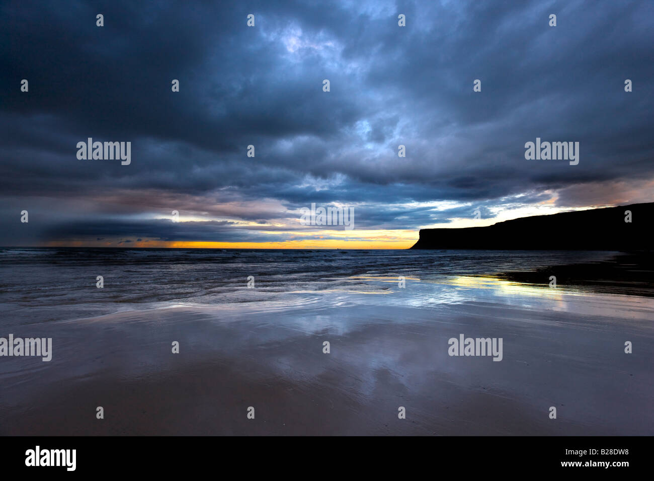 Stormy sky at low tide Huntcliff Saltburn Cleveland - Stock Image