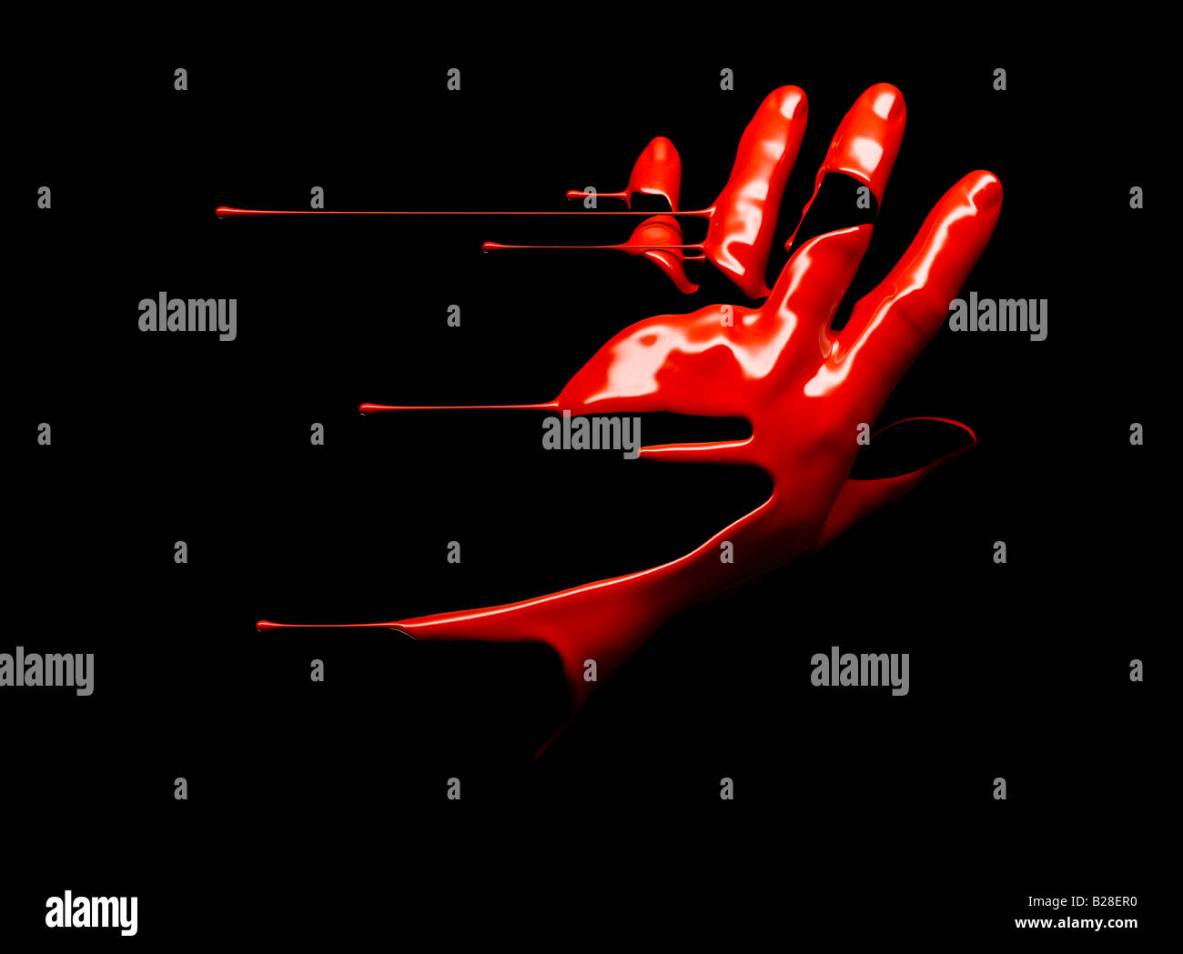 A red liquid hand - Stock Image