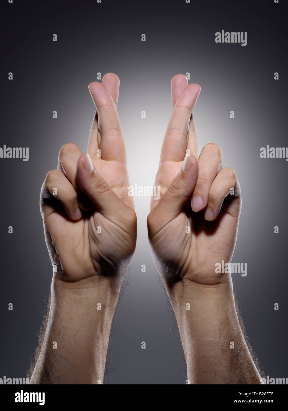 Keep both fingers crossed - Stock Image