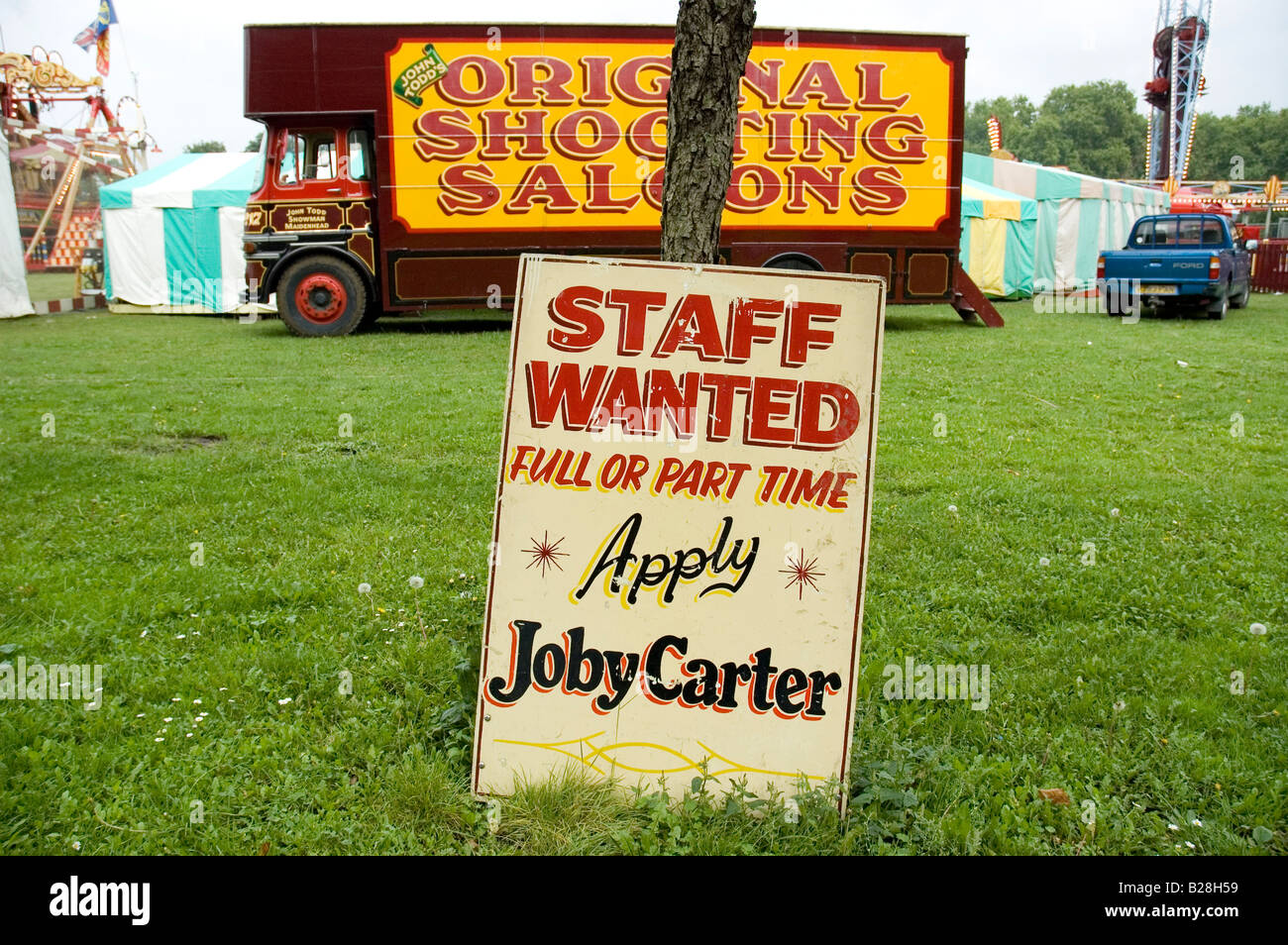 Sign for job vacancy saying 'Staff Wanted' at Carters Steam Fair, Victoria Park, London, UK - Stock Image