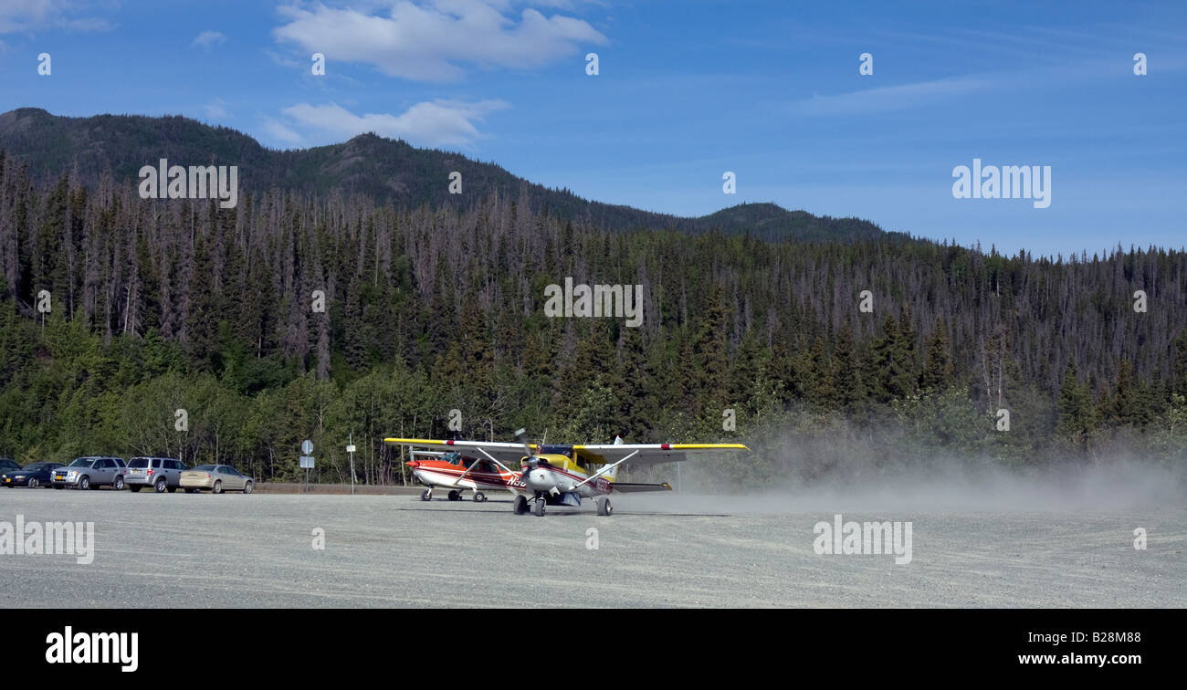 Small airplane taxiing on the dirt strip of Chitina, Alaska. - Stock Image
