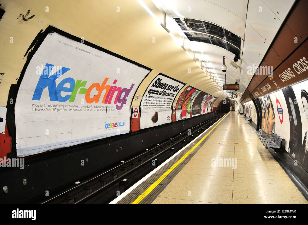 Posters at Charing Cross tube station, London, UK - Stock Image