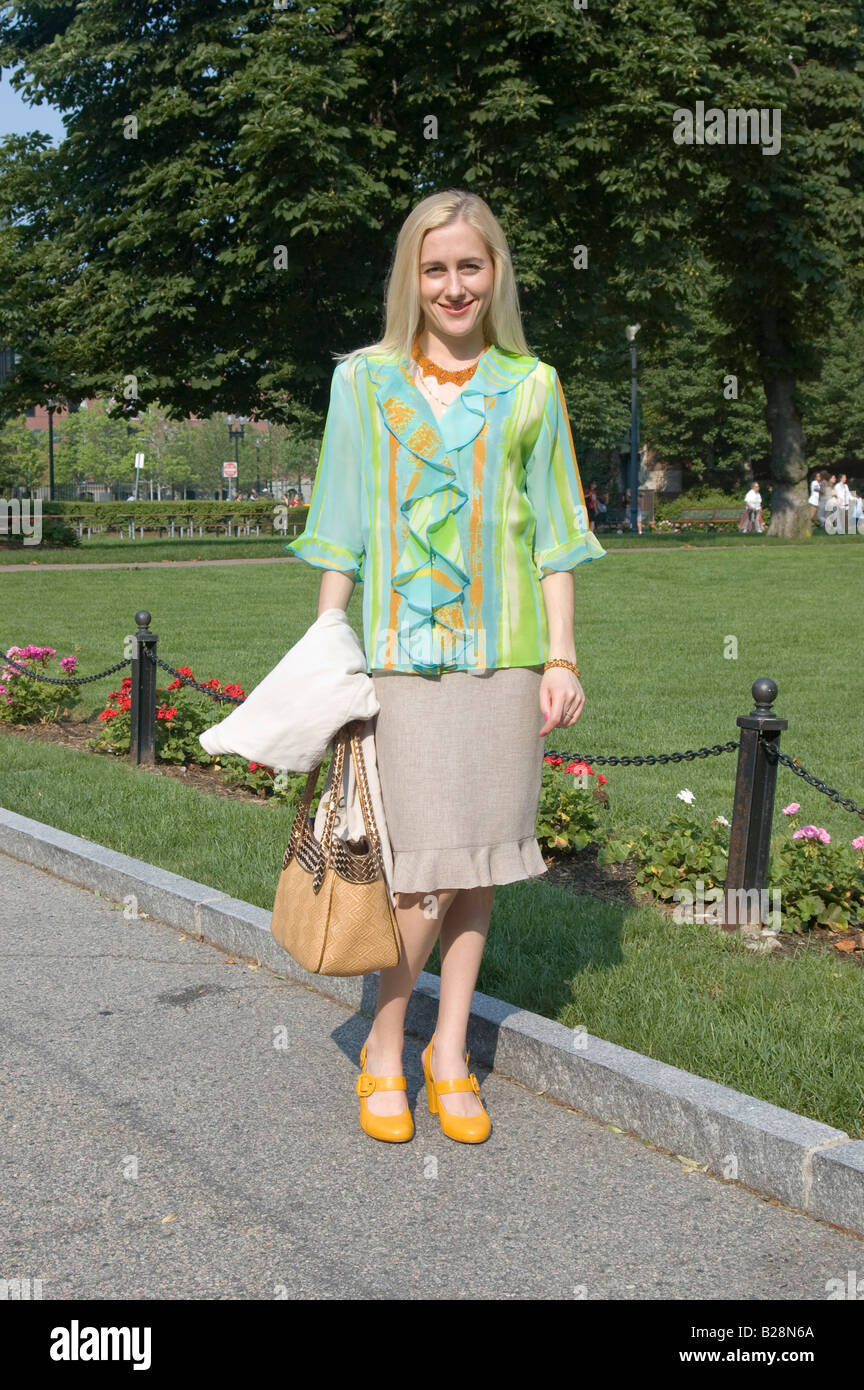 A Beautiful Confident Blonde Woman In Business Casual Dress
