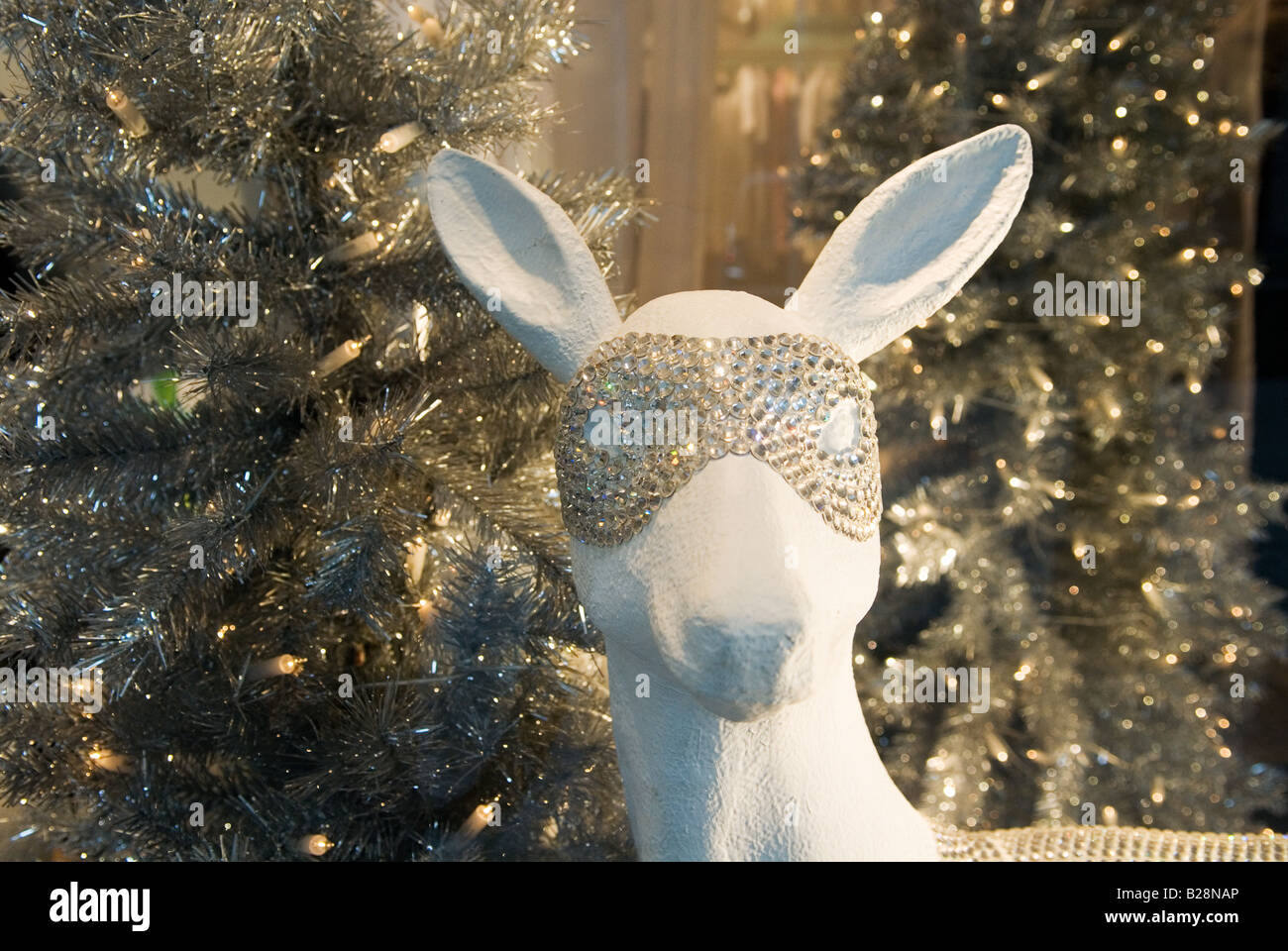 figure of a white deer wearing studded mask extravagant christmas decoration in shop window in duesseldorf