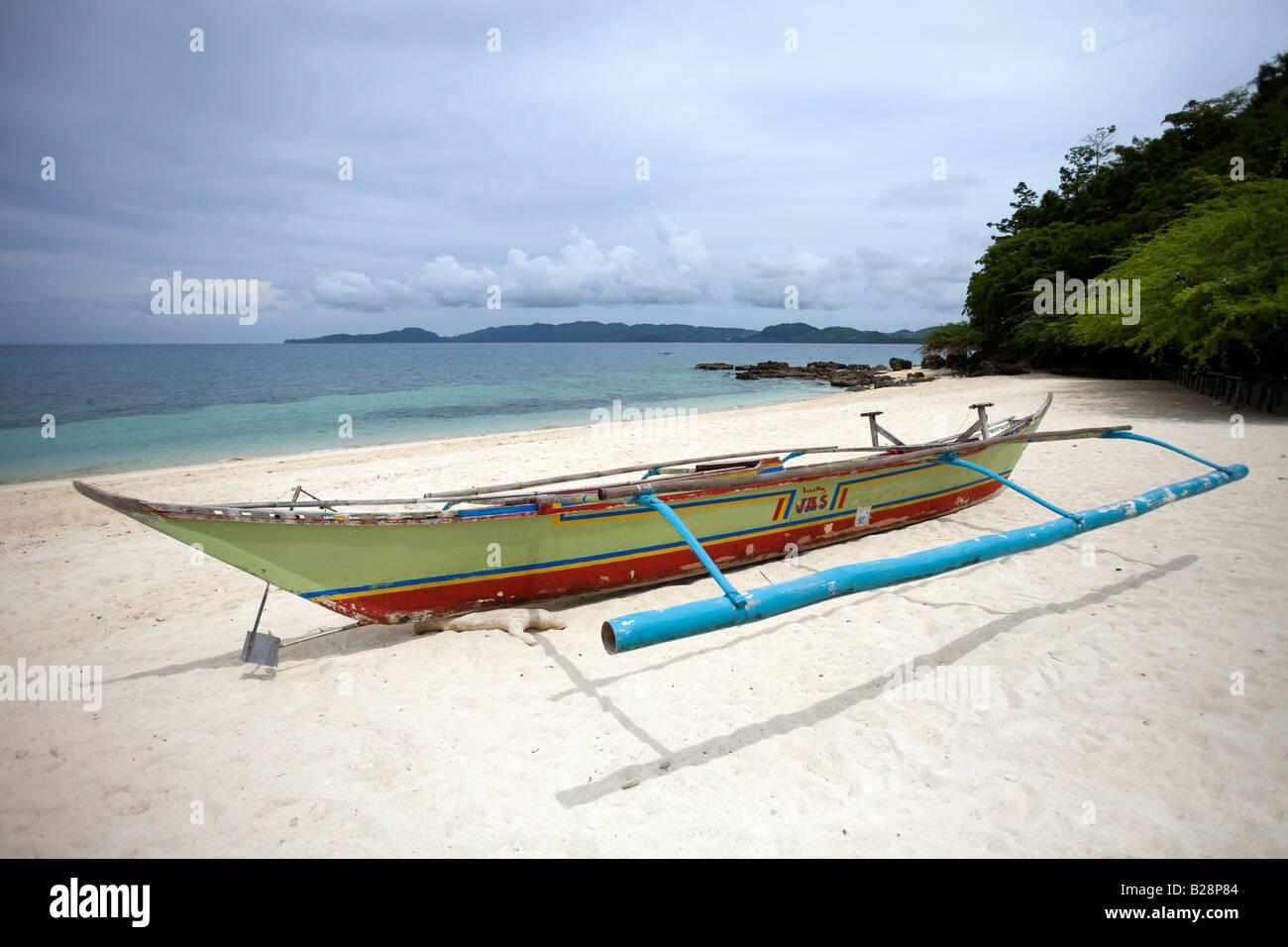 a bangka boat pictured on buktot beach near mansalay oriental stock