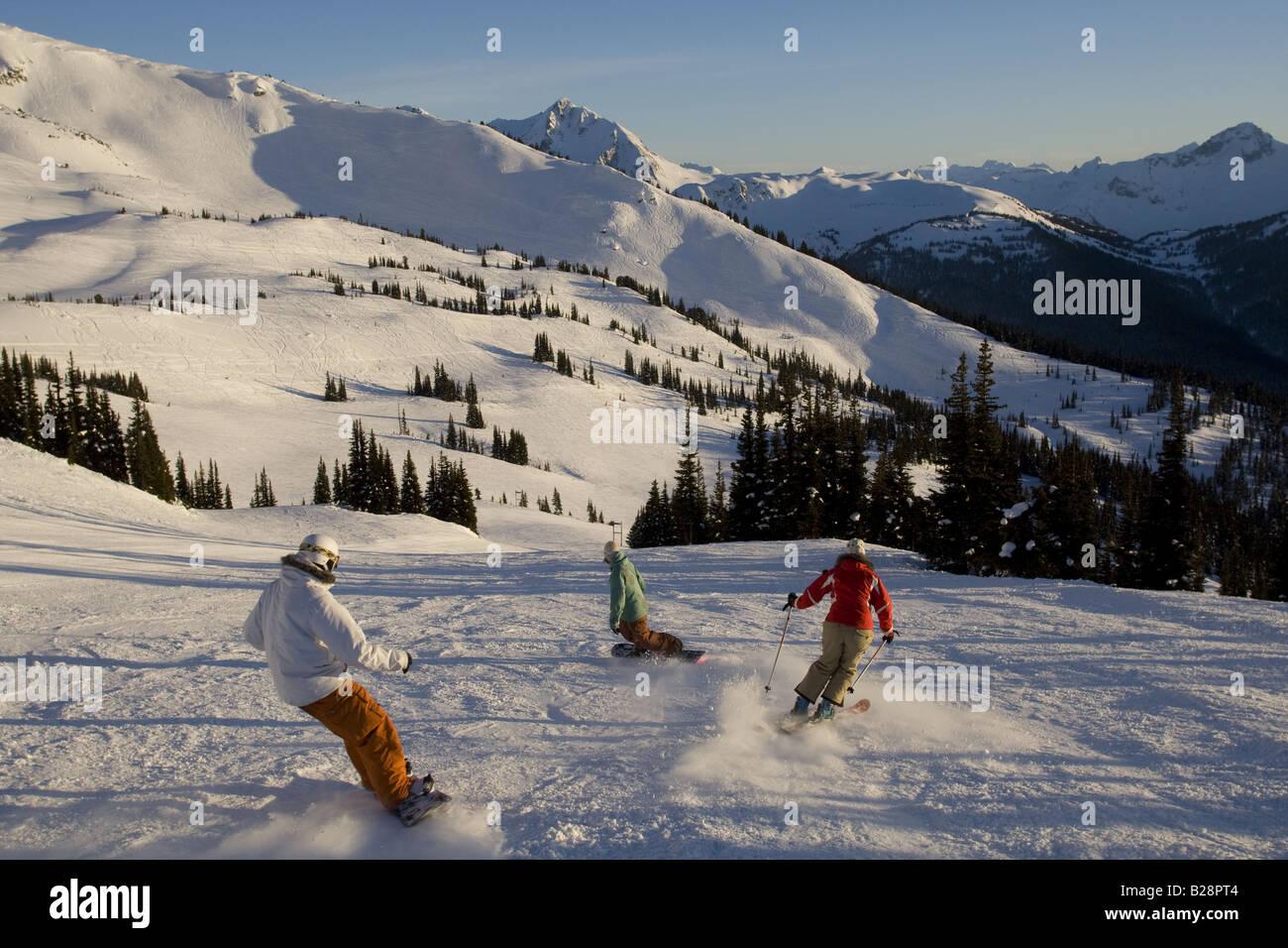 Enjoying skiing on groomed runs Whistler British Columbia Canada - Stock Image