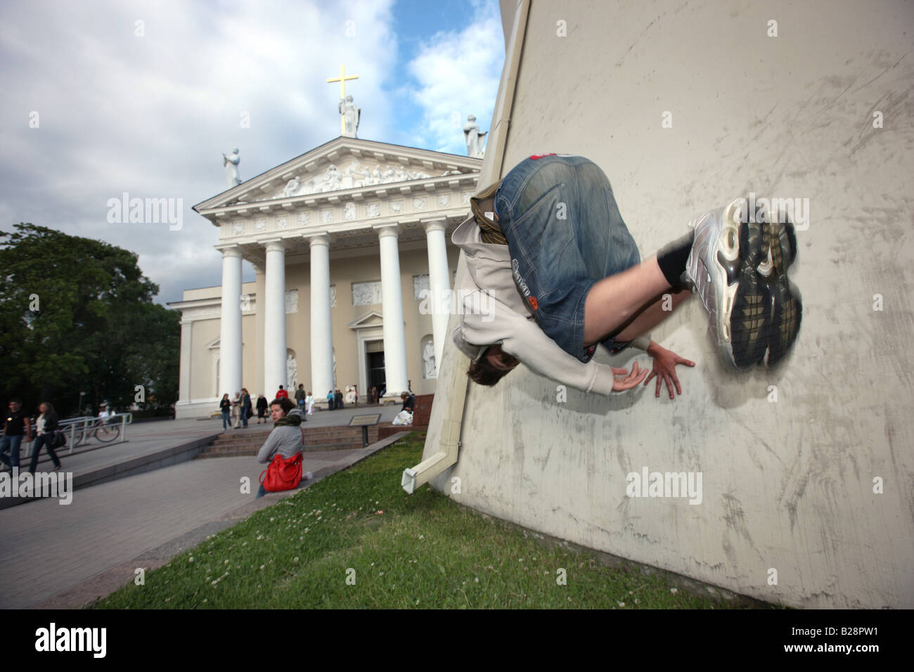 LTU Lithuania Capital Vilnius Kids doing jump action at the cathedral square - Stock Image
