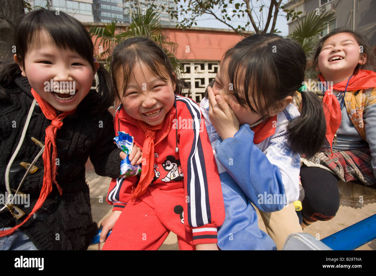 Children in the playground of a primary school in Hong Ying Road Xian China has a one child policy to limit population - Stock Image