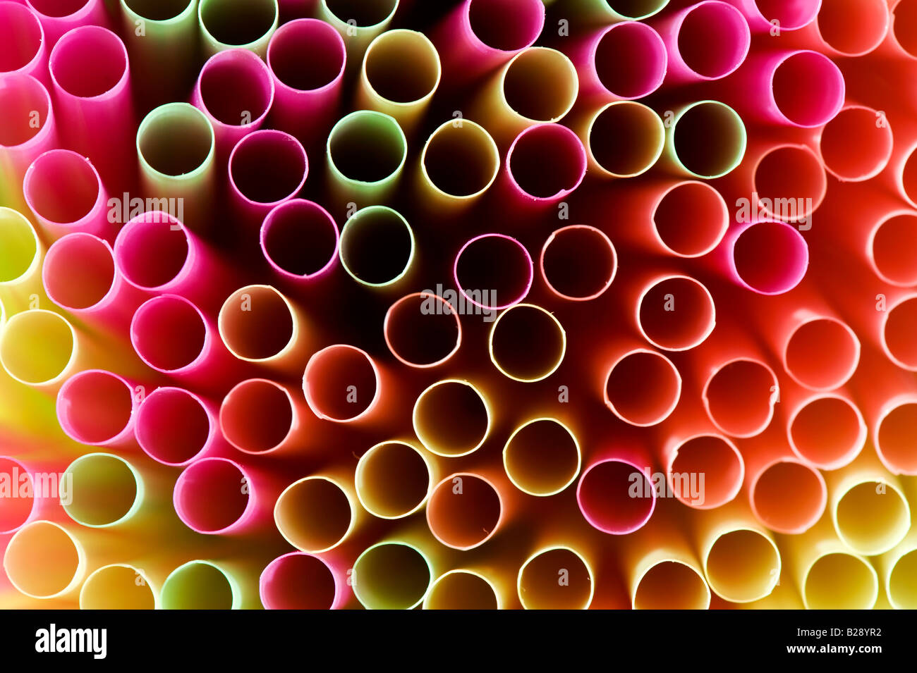 Colourful drinking straws abstract pattern - Stock Image