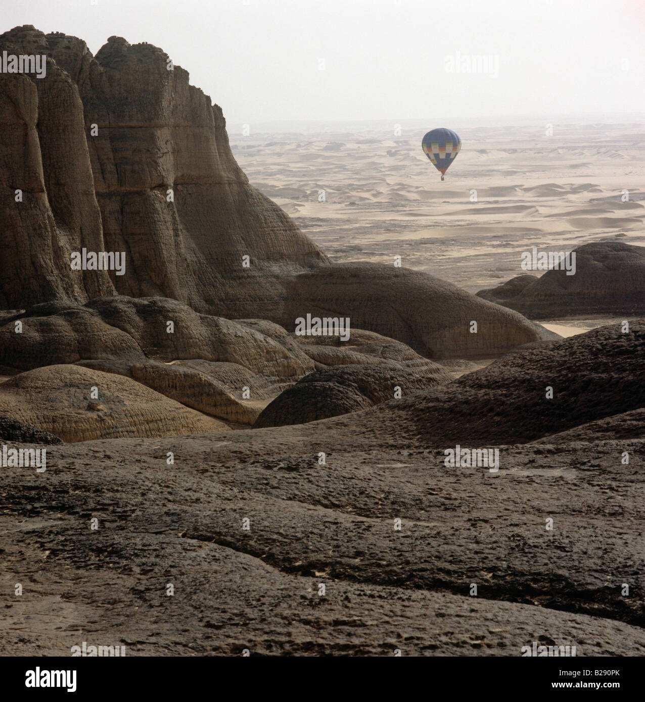 Balloon flying over  desert in background Tassili du Hoggar Algeria Sahara Pictures Photoshot - Stock Image