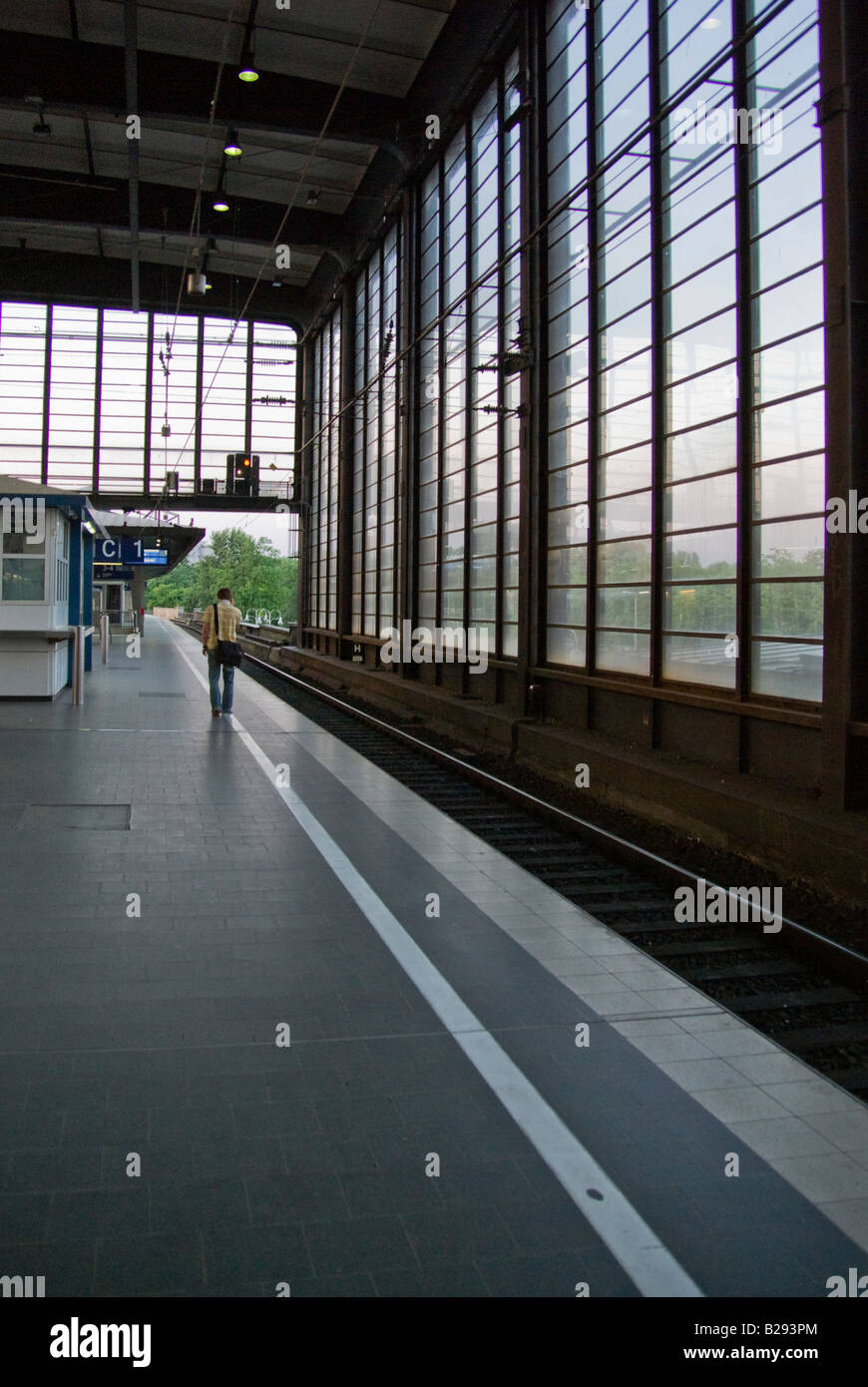A lonely guy talking to a cellphone on an S-Bahn railway station in Berlin Stock Photo