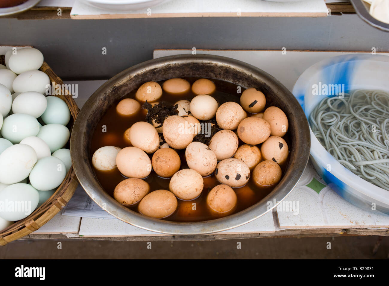 Preserved 1000 year old eggs 6 months old on display at food stall in Fengdu China - Stock Image