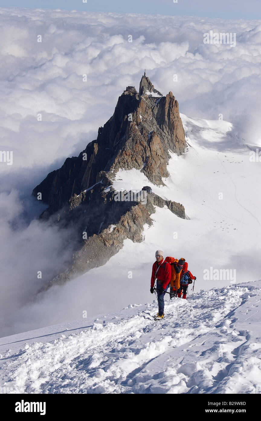 Climbers ascending from the Aiguille du midi Chamonix France Stock Photo