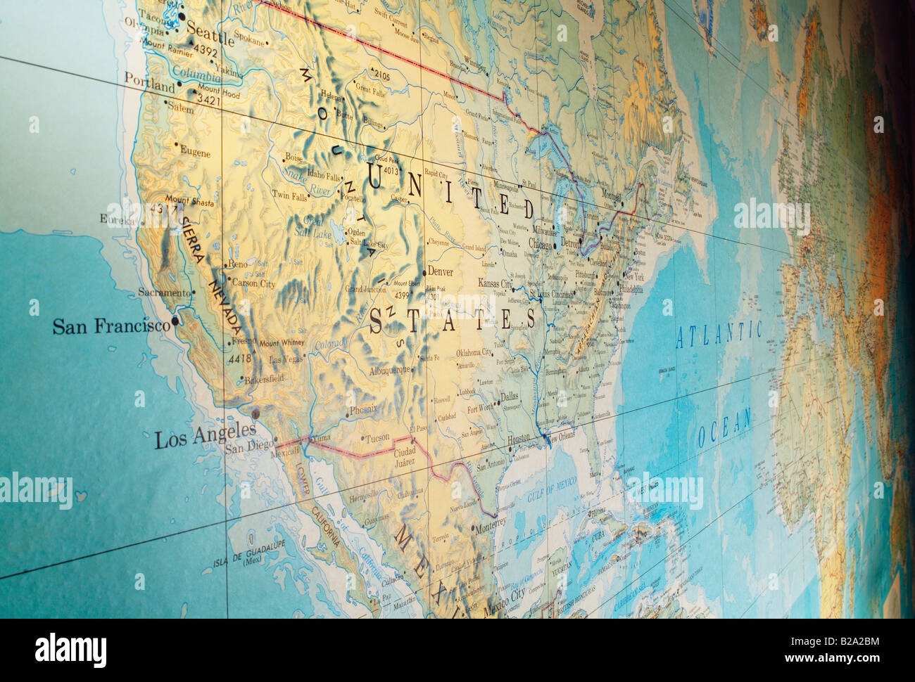 Old stained and yellowed wall map from the 1960s. United states in the foreground EDITORIAL USE ONLY - Stock Image