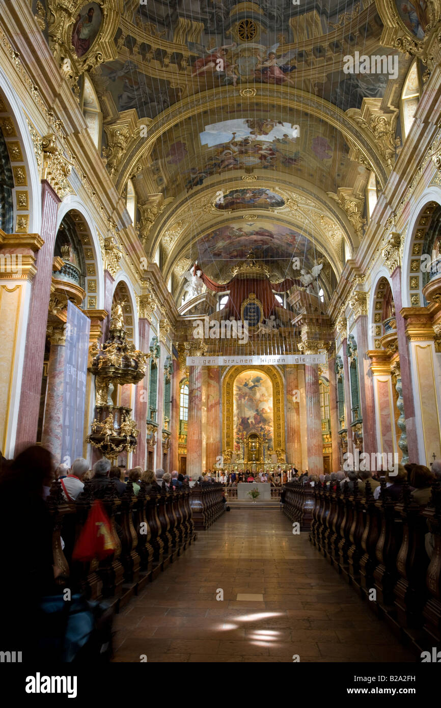 Congregation inside the 17thC Jesuit Church Vienna Austria Also known as the Church of the Franciscan Order - Stock Image