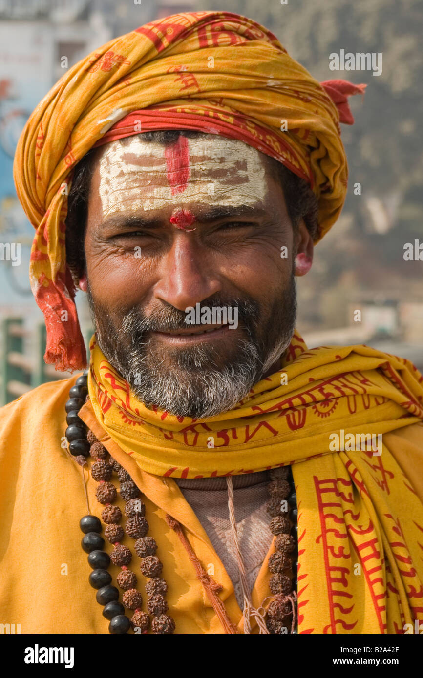 Portrait of a religious man,Sadu,holy men from Nepal. Wearing traditionnal yellow costume. - Stock Image
