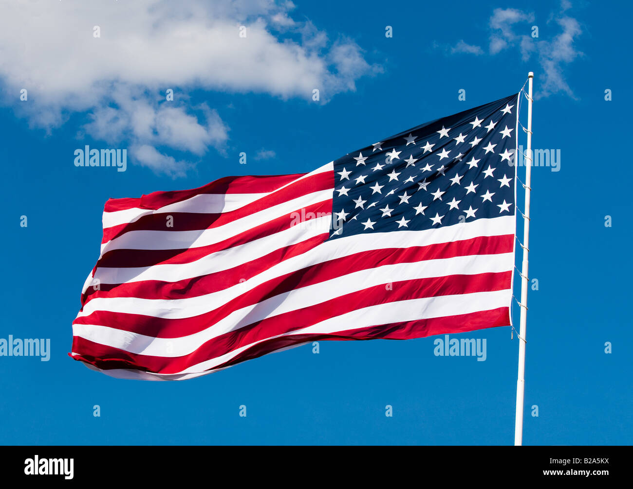 american flag over blue sky background - Stock Image