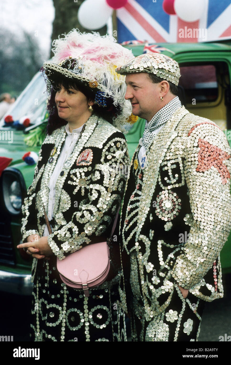 Pearly Kings Queens Pearlies traditional costume Cockney English tradition man woman couple London England UK - Stock Image