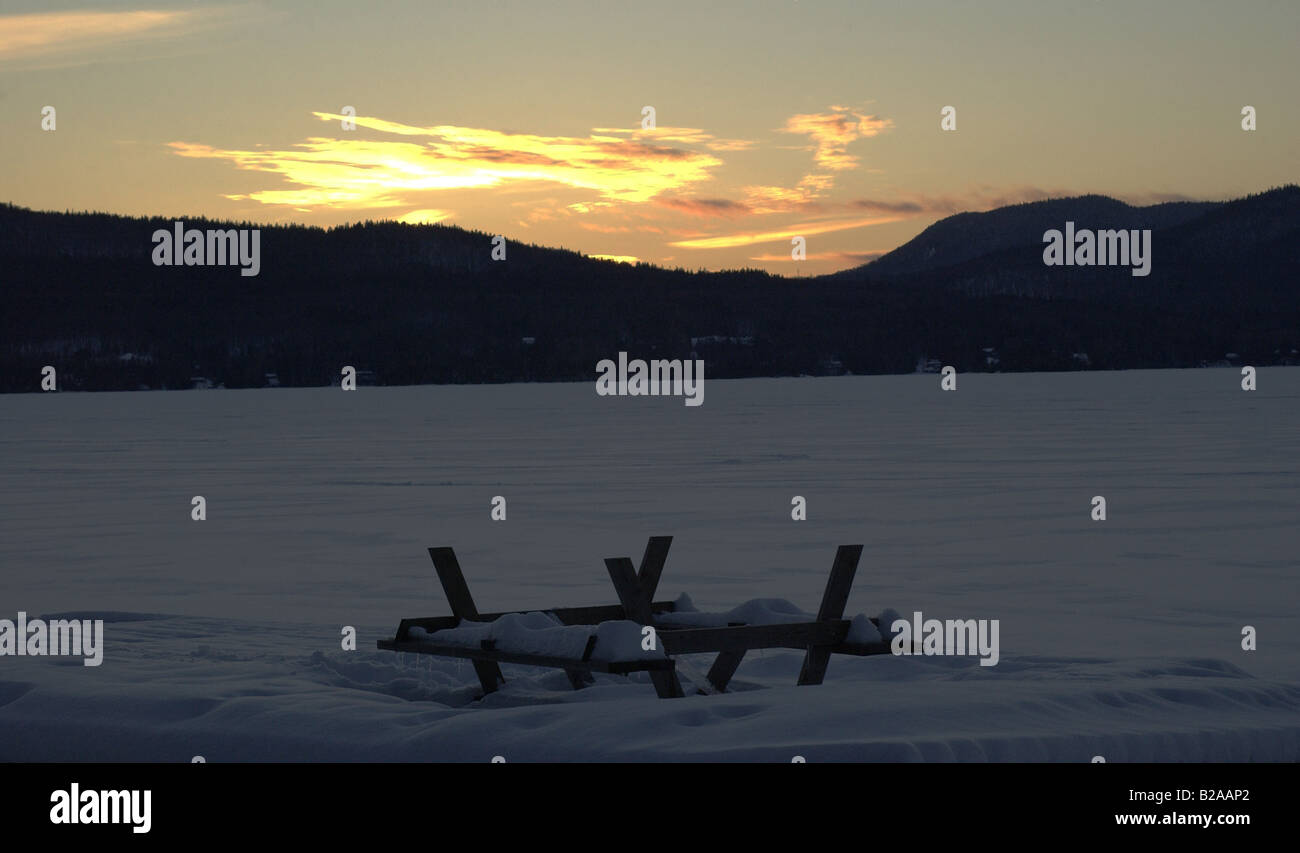 The winter series, images that capture the essence of the Canadian Quebec winter. An upside down picnic table gathers - Stock Image