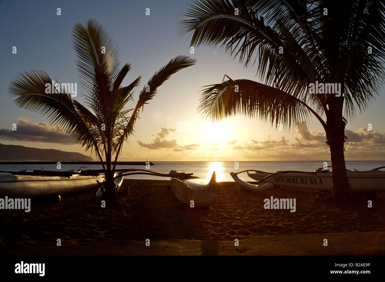 Outrigger Canoes at Sunset on the North Shore of Oahu Hawaii USA Stock Photo