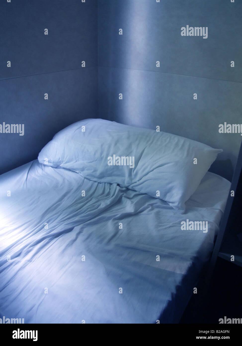 One Empty Bed Matress In Dark Bedroom