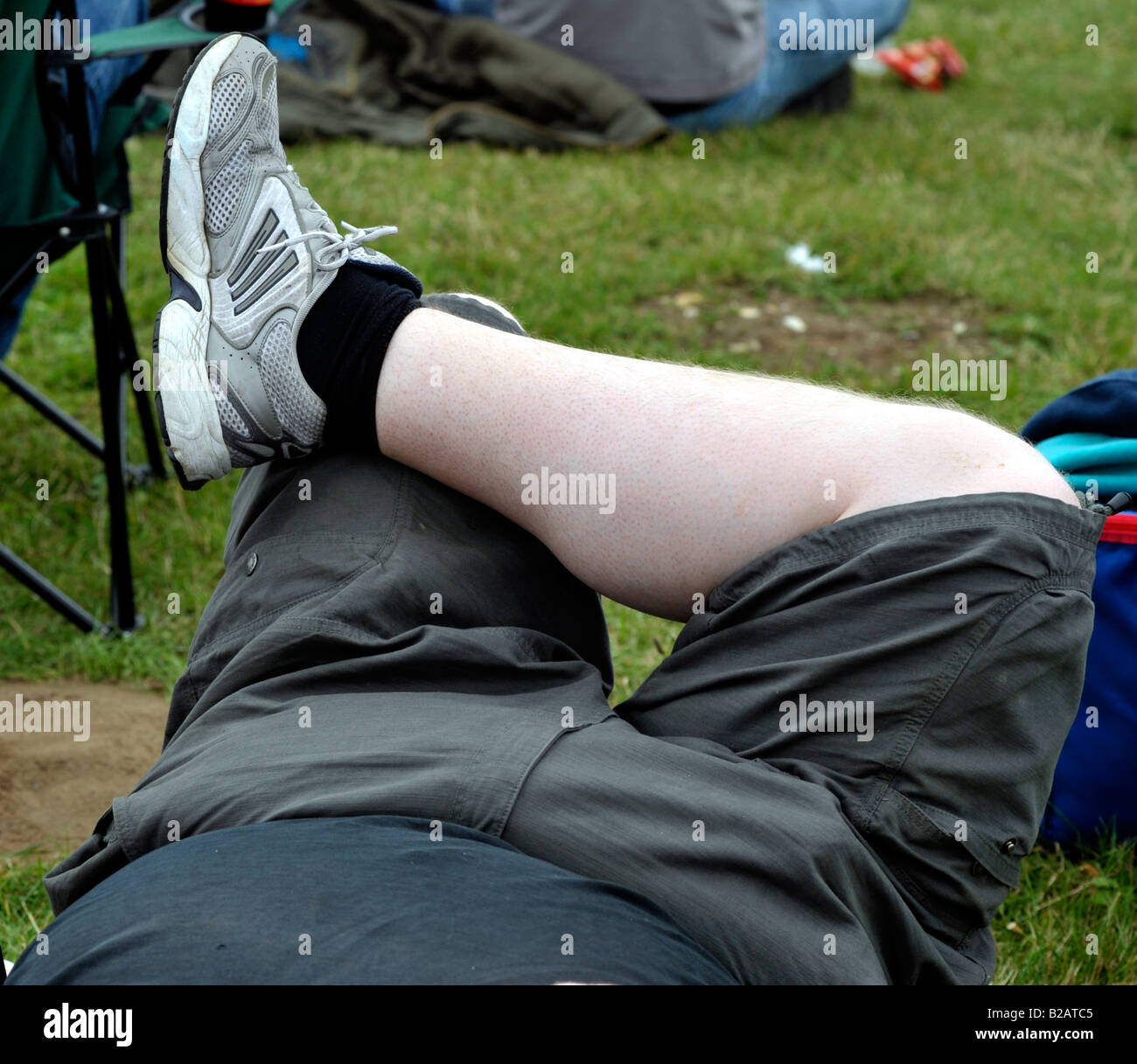 obese fat man laying down Stock Photo