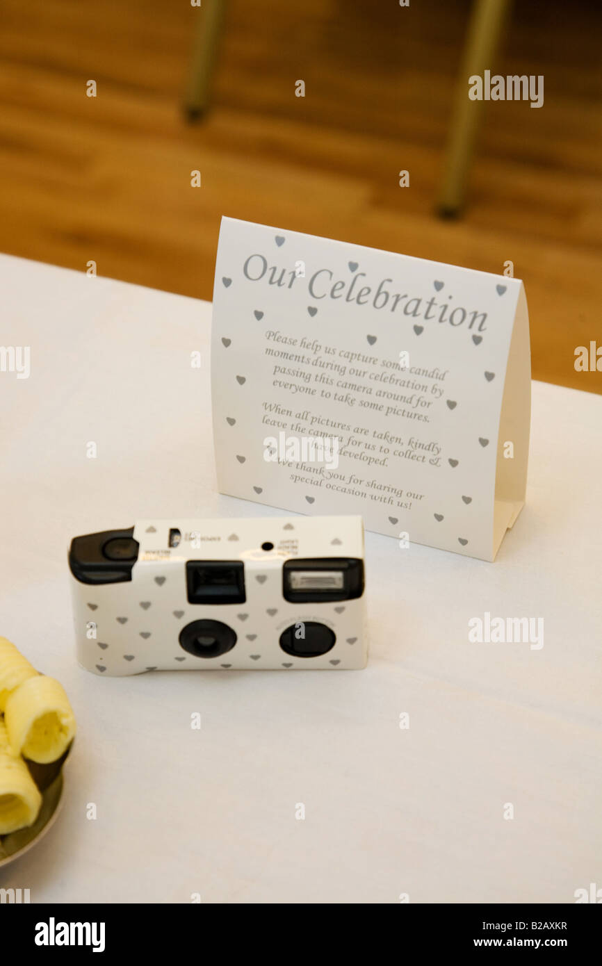 A Disposable Camera On A Table At A Wedding Reception Stock Photo