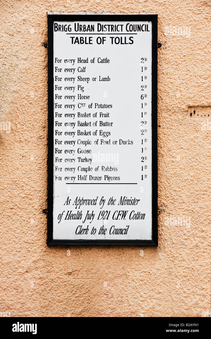 Restored Toll Board at Brigg, Lincolnshire. Gives the charges for bringing animals and goods into the town. Dated Stock Photo