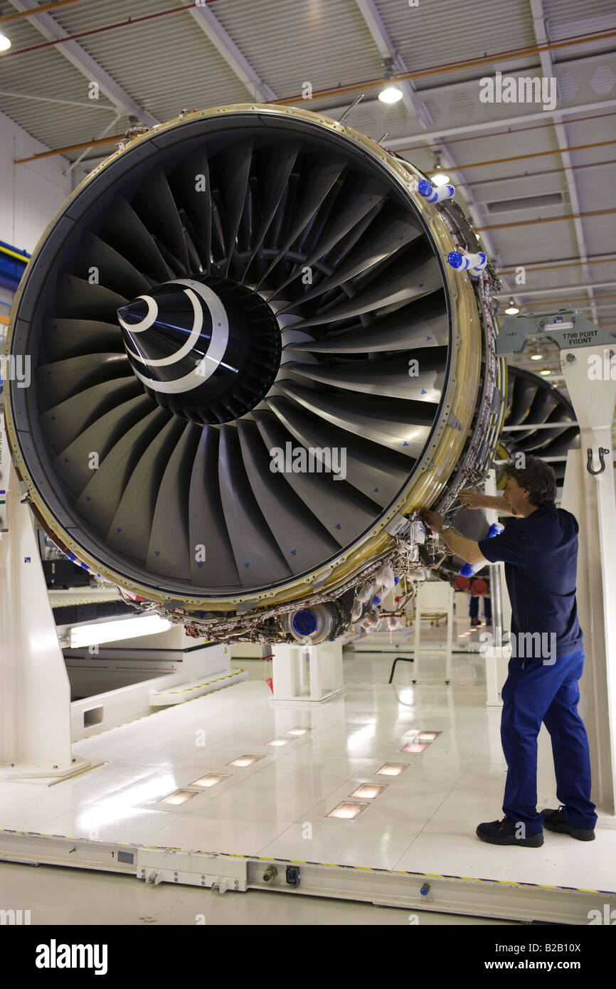 Enginer works on a Rolls Royce jet engine in the production factory Derbyshire United Kingdom - Stock Image