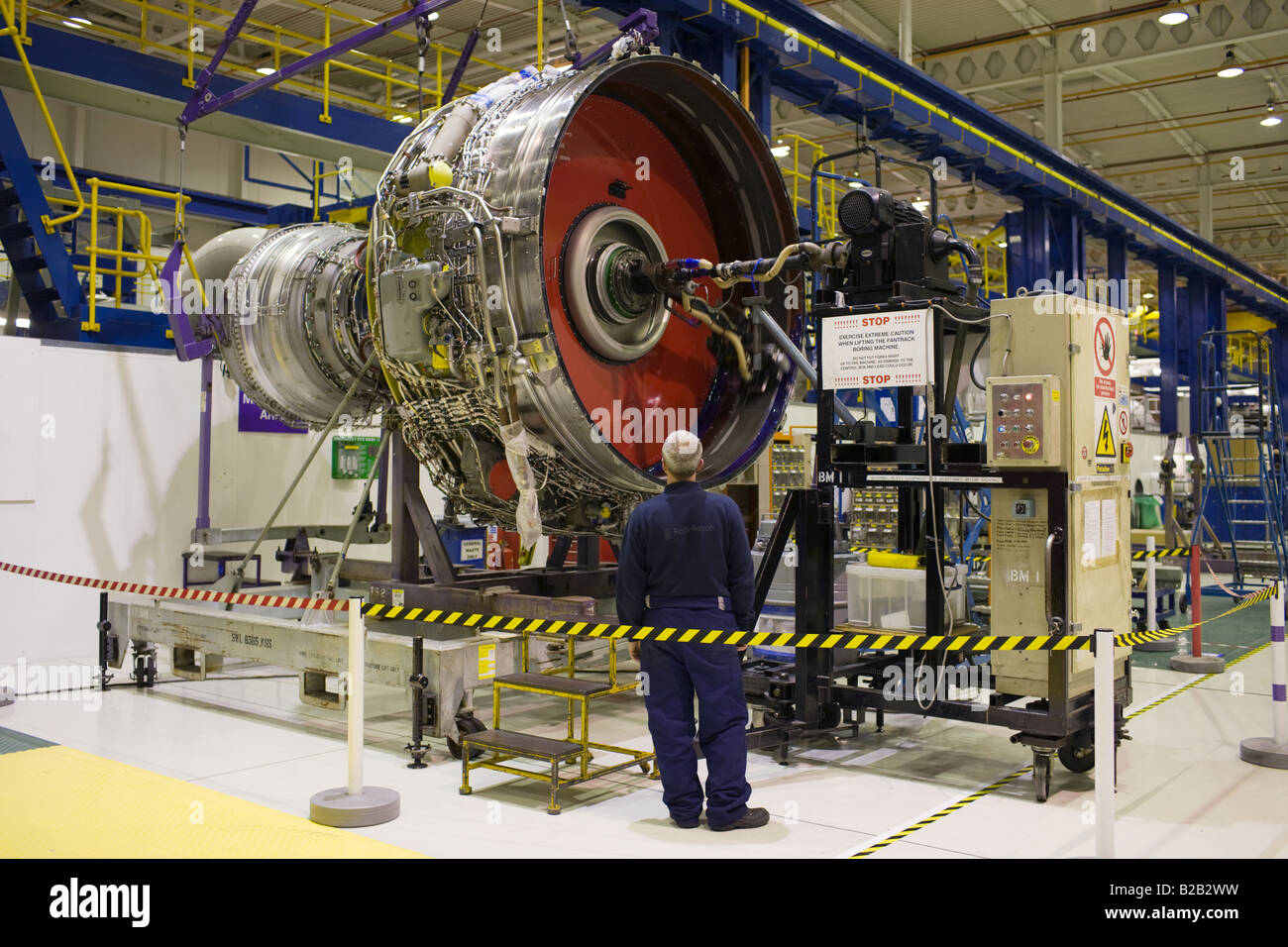Enginer works on a Rolls Royce jet engine in the production factory Derbyshire United Kingdom Stock Photo