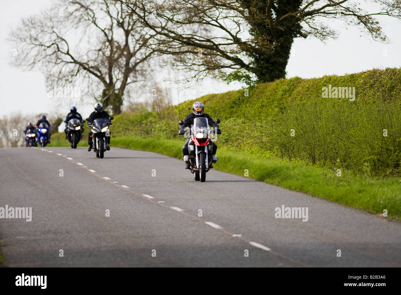 Motorcyclists on country road Stow On The Wold Oxfordshire United Kingdom - Stock Image