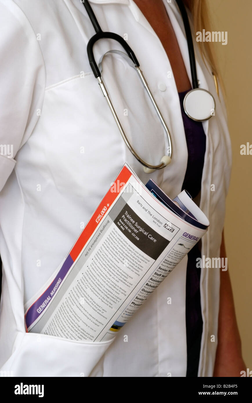 Job advert publication in uniform pocket of a member of the medical profession - Stock Image