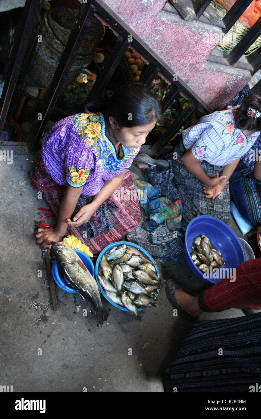 A local woman selling fish in a market in Santiago Atitlan in the highlands of Guatemala, Central America - Stock Image
