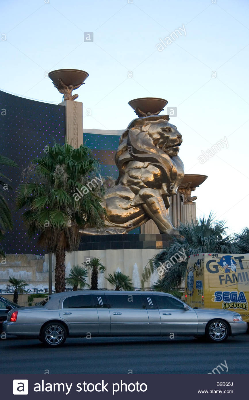 A limousine on the strip in front of the lion statue of the MGM hotel - Stock Image