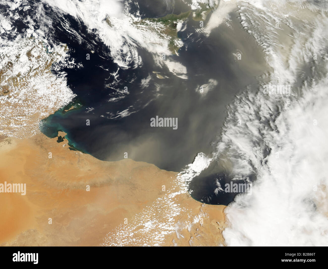 Dust plumes blowing off the north African coast and over the Mediterranean Sea. - Stock Image