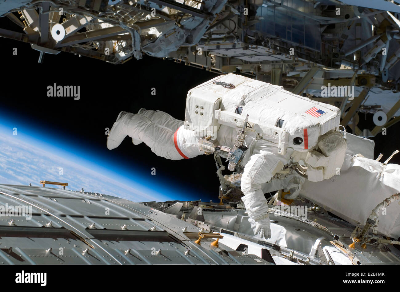Astronaut participates in extravehicular activity during STS-124. - Stock Image