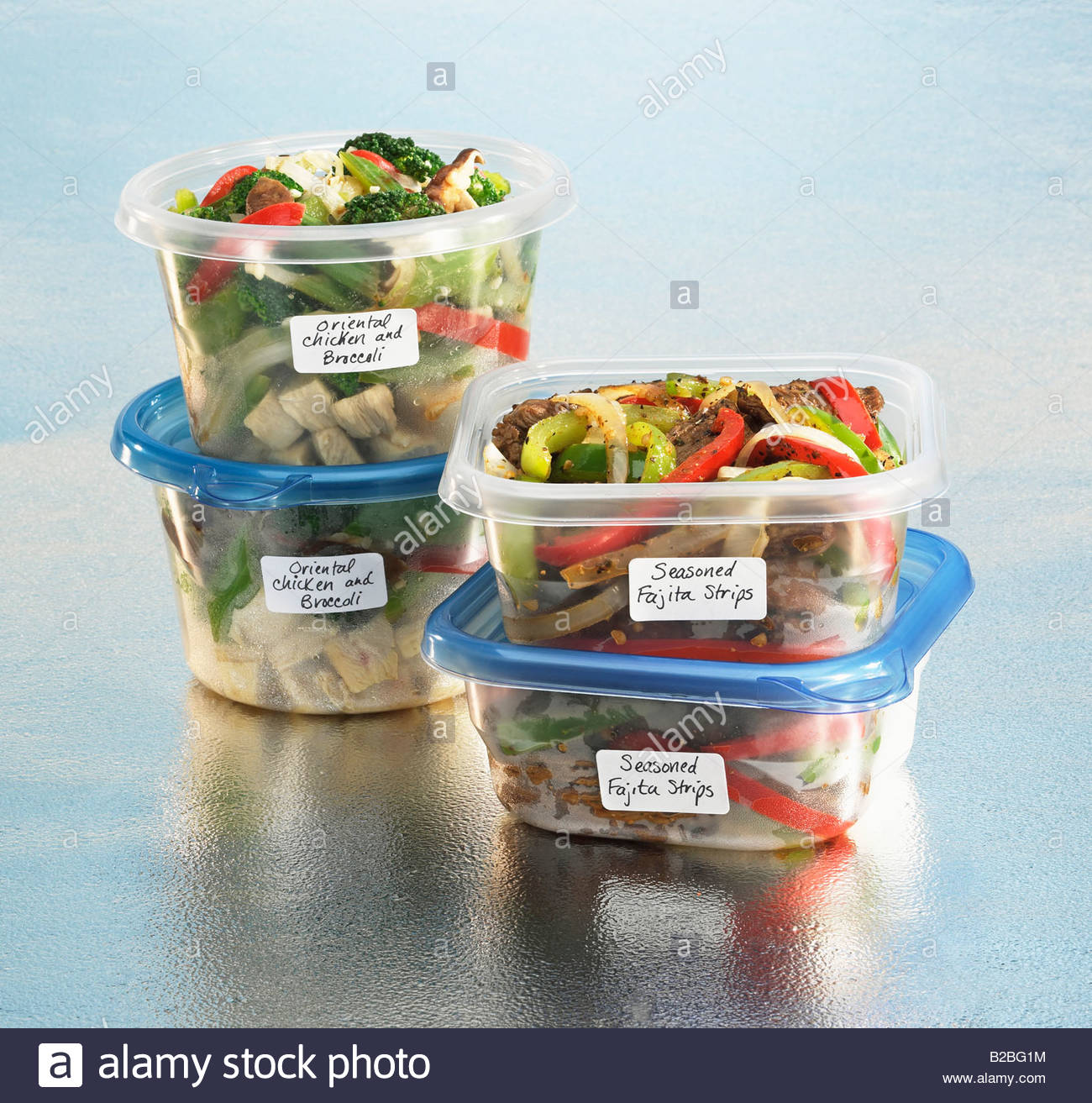 Food in labeled plastic containers - Stock Image