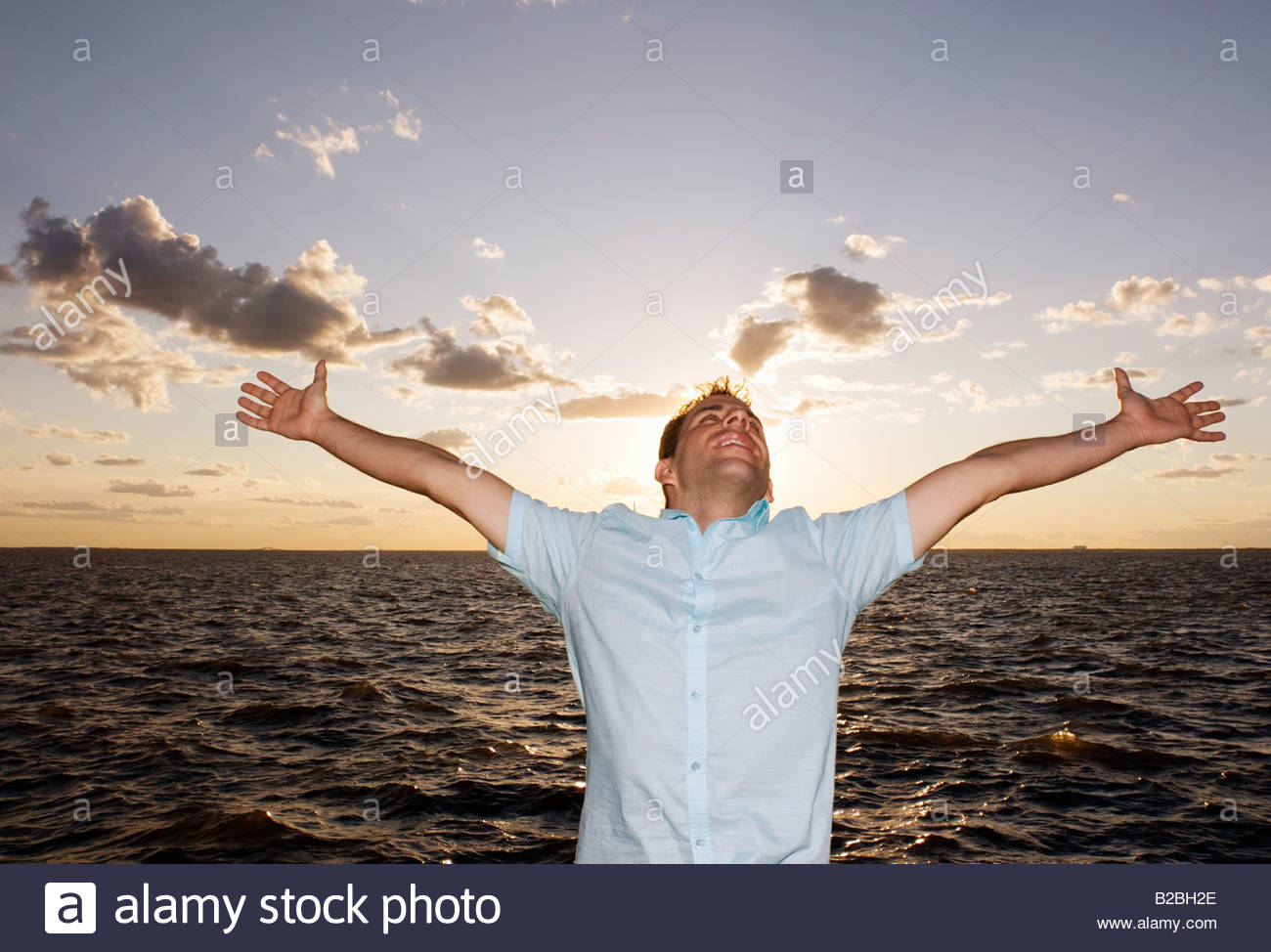 Man with arms outstretched - Stock Image