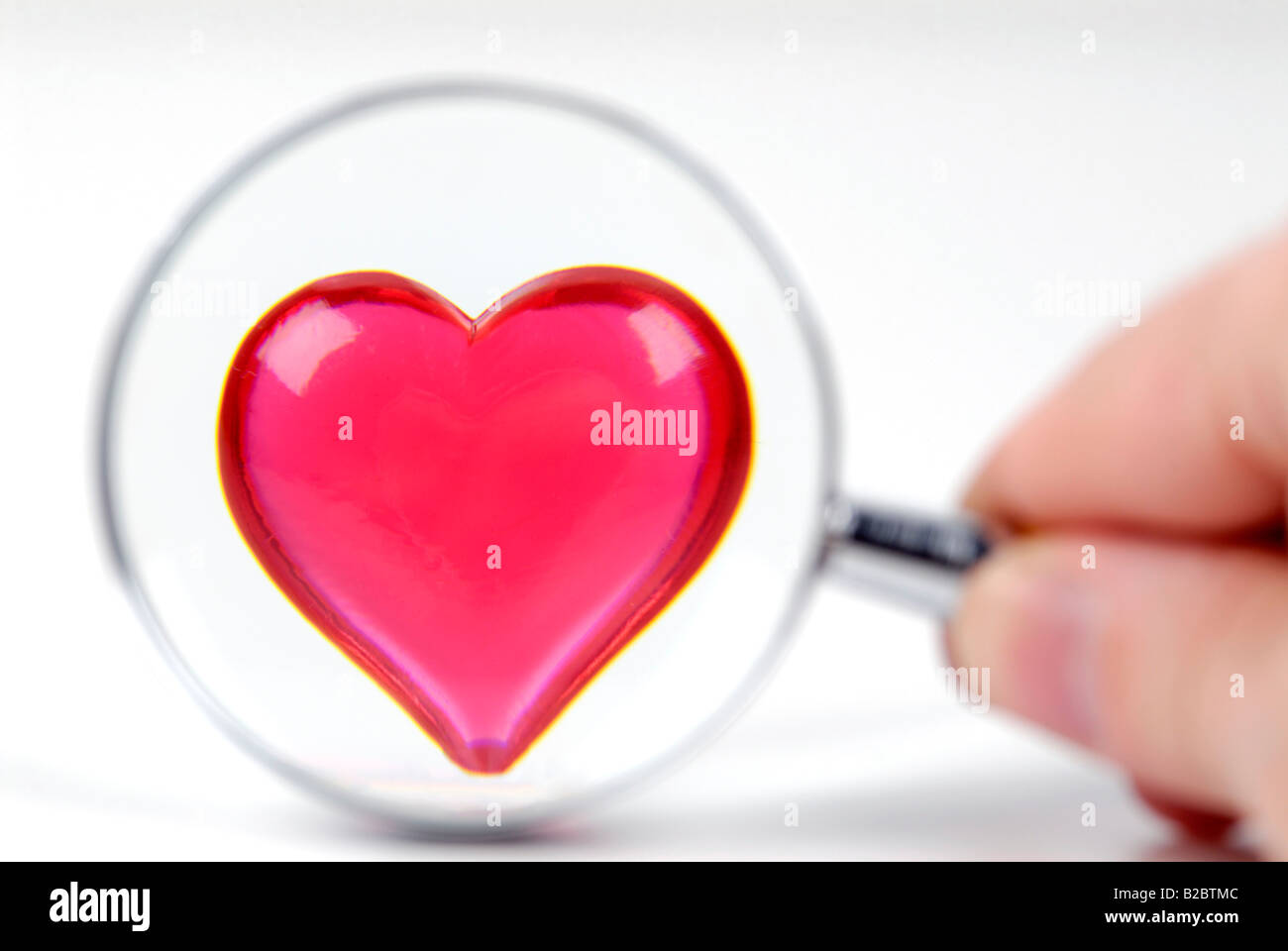 Heart under a magnifying glass - Stock Image