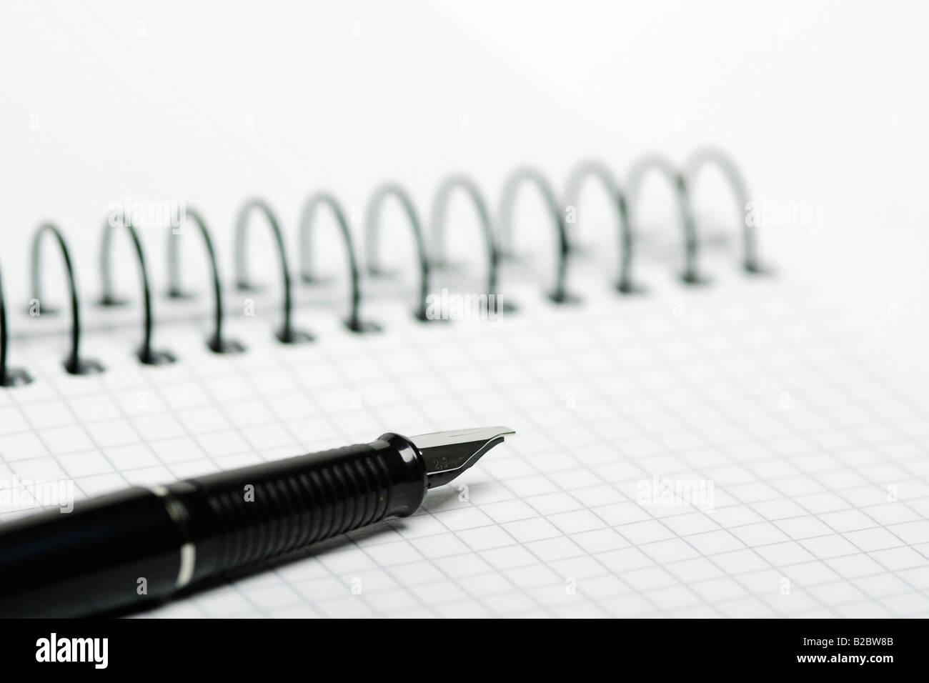 Fountain pen on a notebook Stock Photo