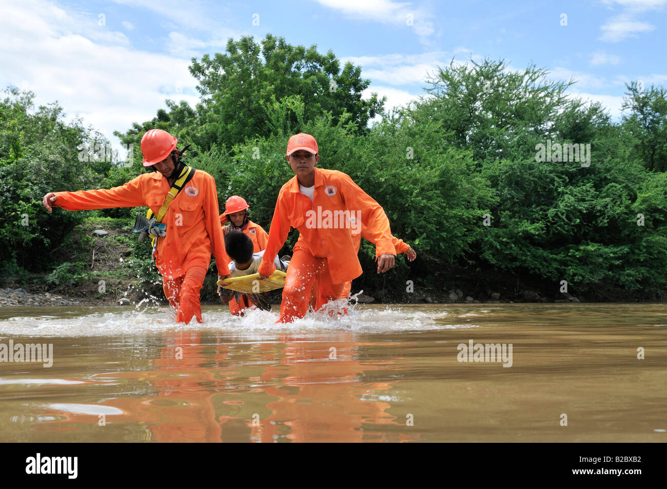Disaster prevention training in a hurricane area, evacuation of an injured person, Somotillo, Chinandega, Nicaragua - Stock Image