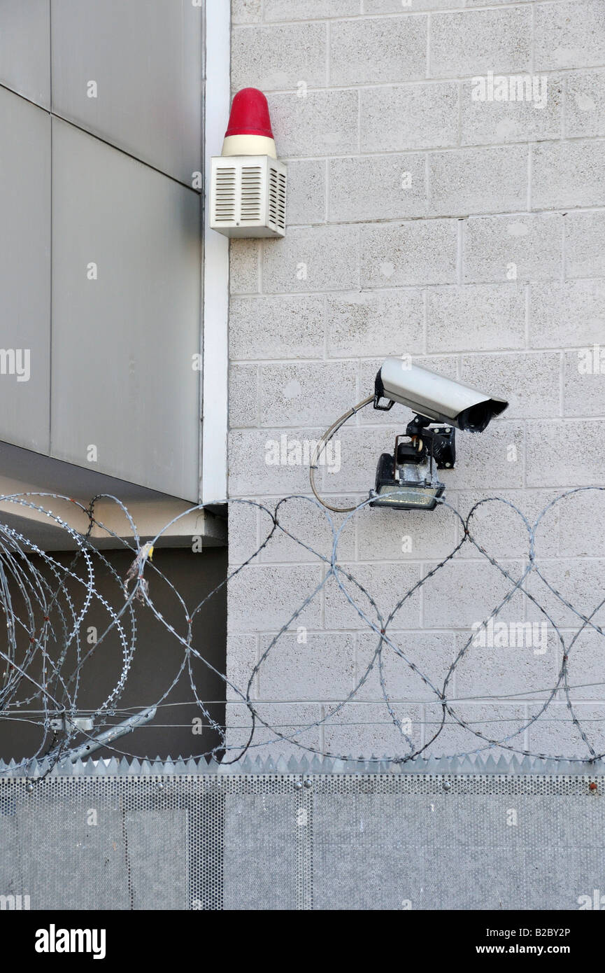 Security system's signalling device, surveillance camera and barb wire fence Stock Photo