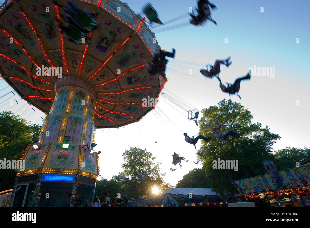 Chair-O-Planes or swing carousel amusement ride at the traditional Waeldchestag celebration, Frankfurt, Hesse, Germany, Stock Photo