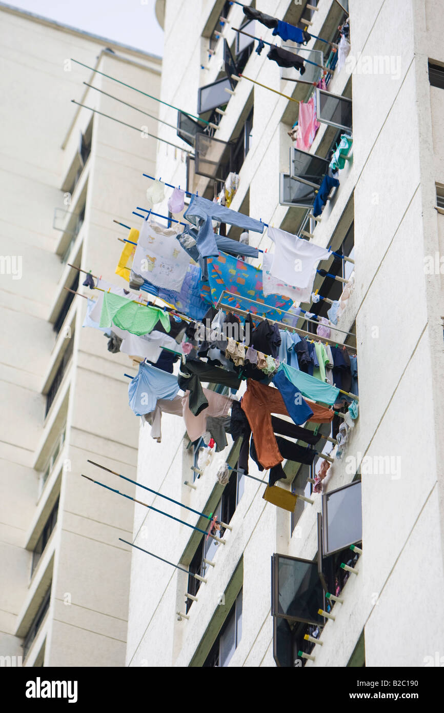 Laundry building stock photos laundry building stock images alamy laundry hanging from windows of an apartment building in the chinese district chinatown neil solutioingenieria Choice Image