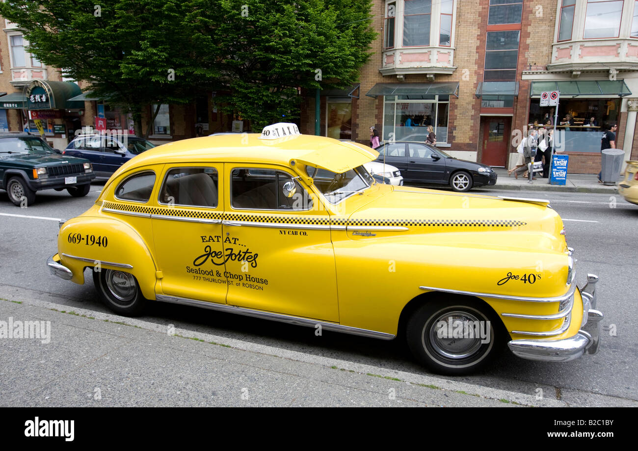 Old taxi with advertisement for a restaurant, Vancouver, British Columbia, Canada, North America - Stock Image