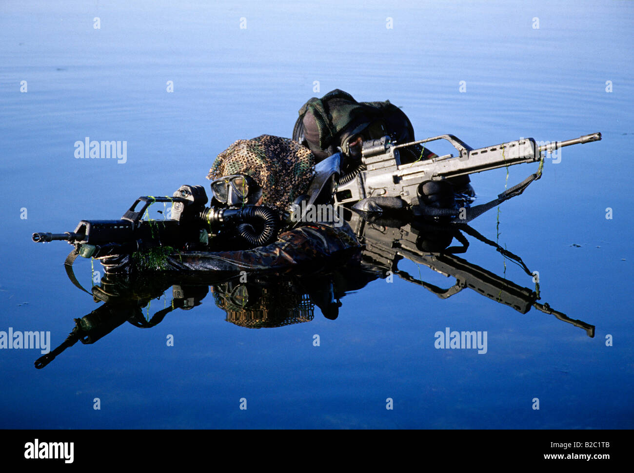 Two soldiers belonging to the Kampfschwimmerkompanie, combat swimmers, special unit of the German Navy practicing - Stock Image